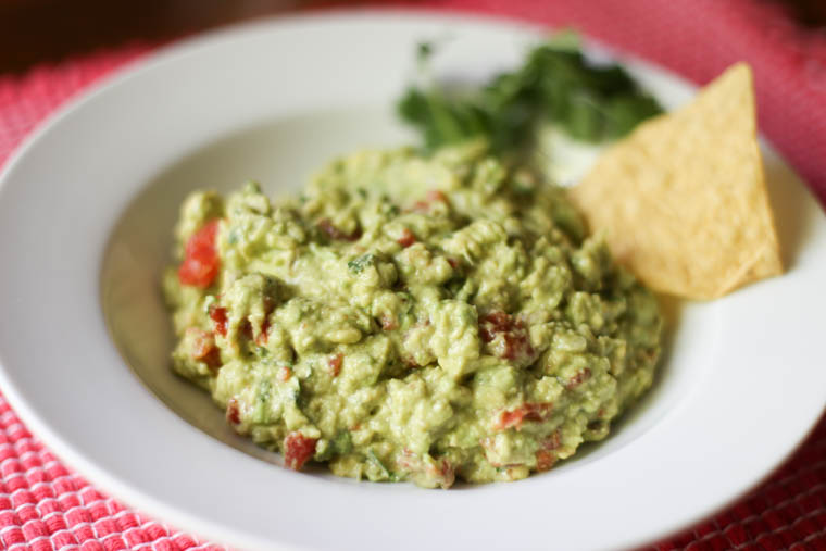 A fabulous guacamole recipe that feeds A LOT of people. So many fresh, real ingredients instead of those packs full of processed ingredients.
