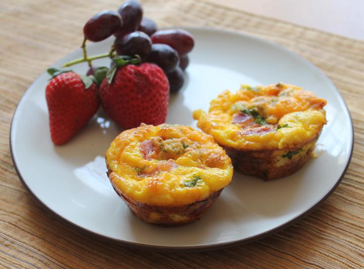 Breakfast Casserole Muffins on a plate with fruit