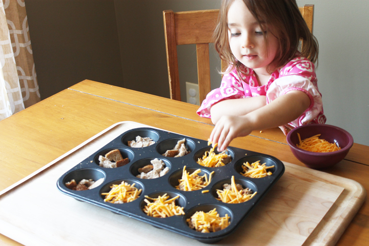 Little girl making breakfast casserole muffins