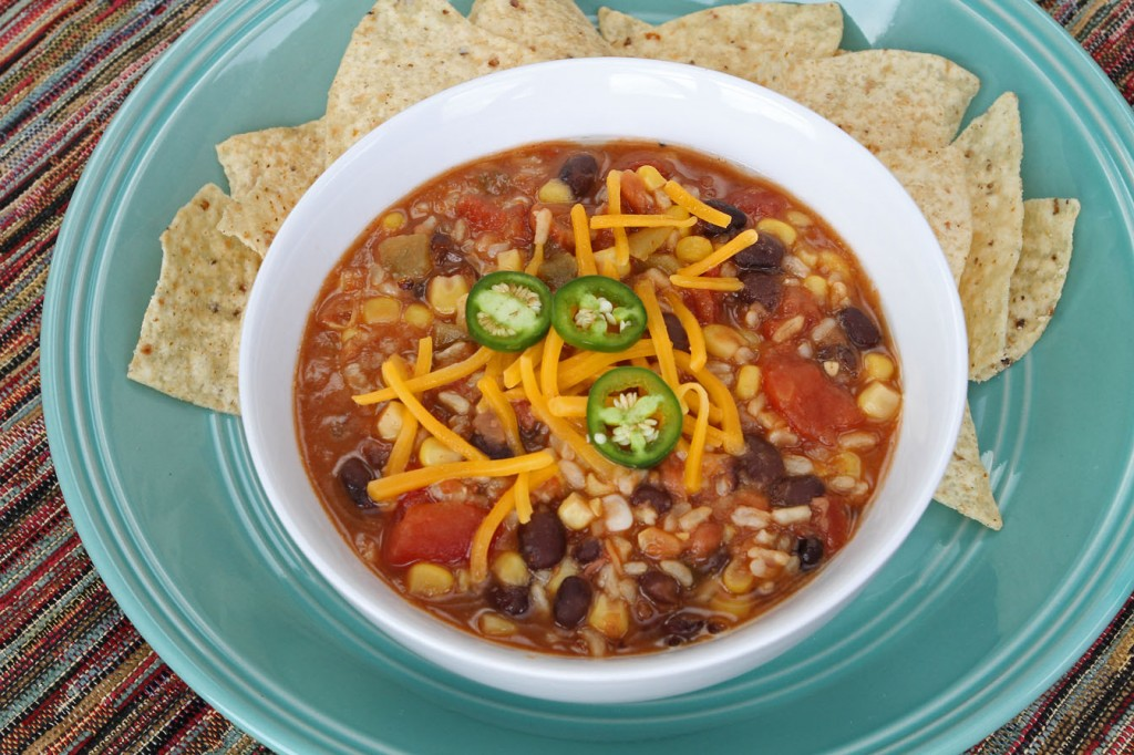 "Vegetarian Tortilla Soup is a meatless ""one pot wonder"" that takes about 10 minutes to make, feeds a crowd, and only gets better the longer it sits. Plus make ahead and freeze for later! #freezermeal #thrivingHome"