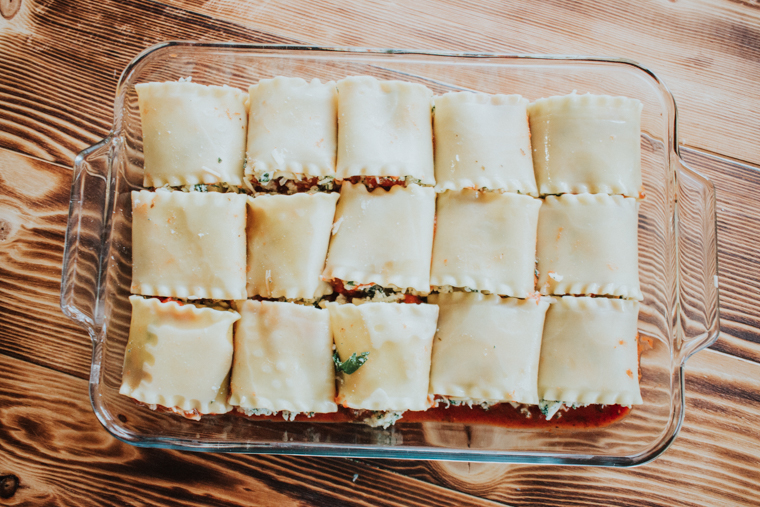 Spinach lasagna rolls in a baking dish