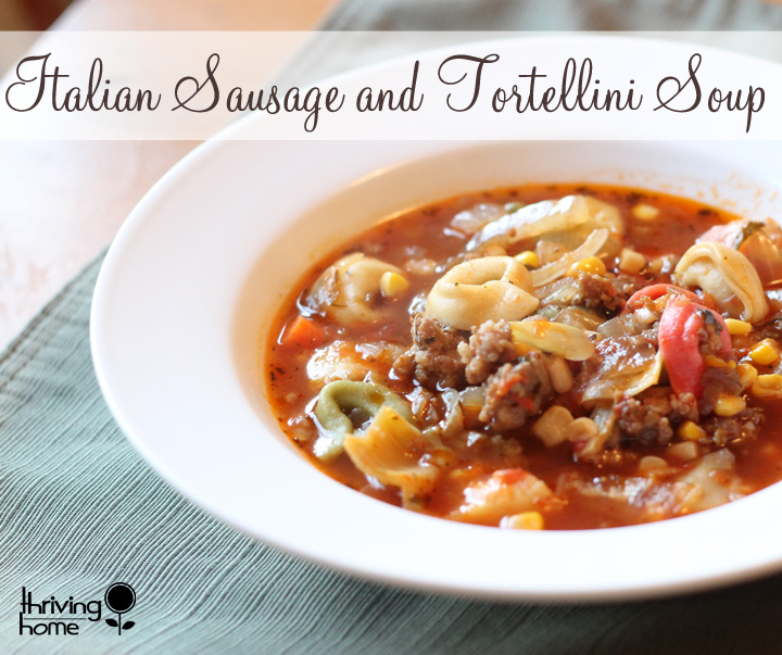 Italian Sausage and Tortellini Soup. Comfort food that is bursting with flavor. This recipe is really filling to so it is great for large families for for large groups. Such a delicious, healthy soup recipe that is freezer friendly! | Thriving Home