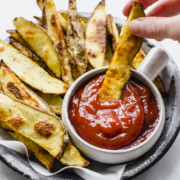 steak fries dipped in ketchup