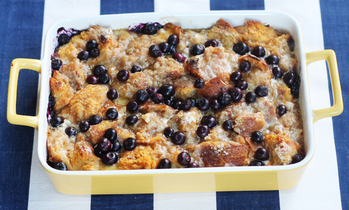 Blueberry pumpkin baked french toast in a yellow baking dish.