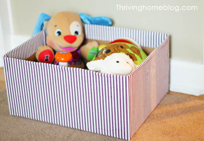 Use fabric to decorate cardboard box