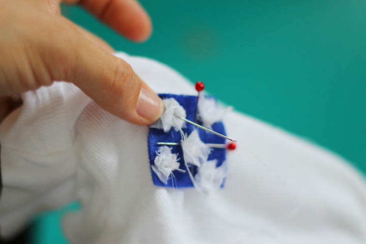 sewing on stars