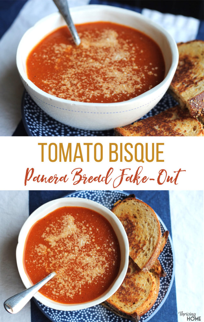 Tomato Bisque soup in white bowl with spoon