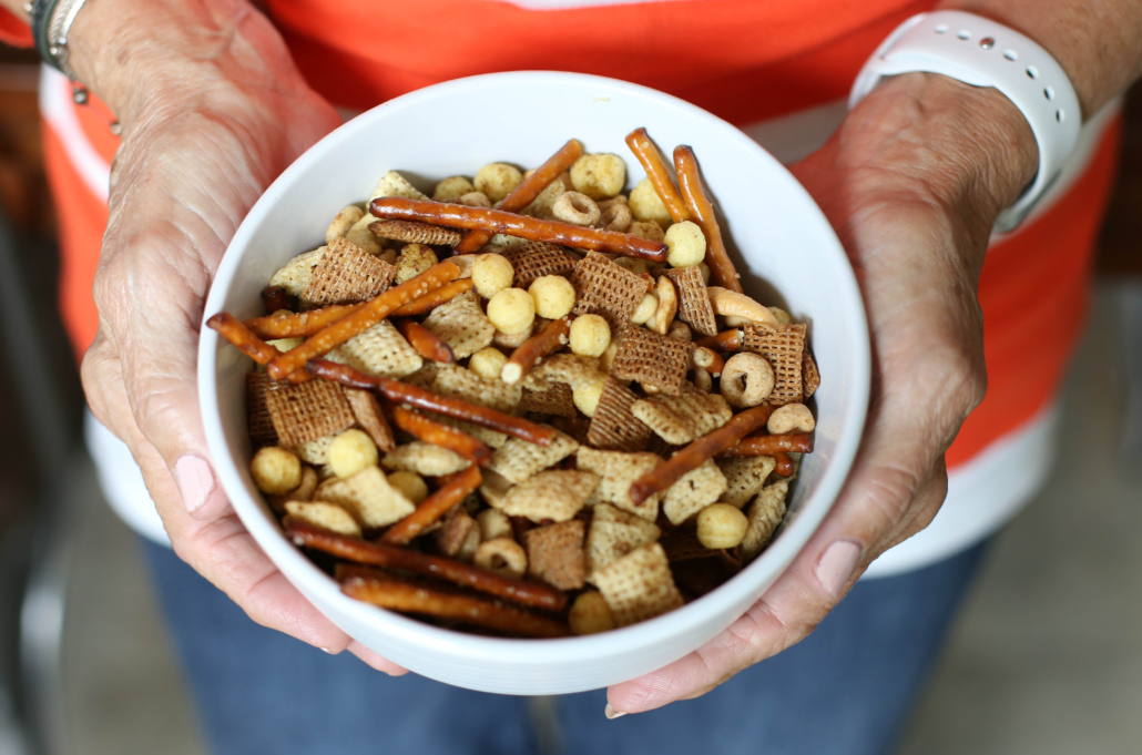 Homemade Chex Mix in a small white bowl