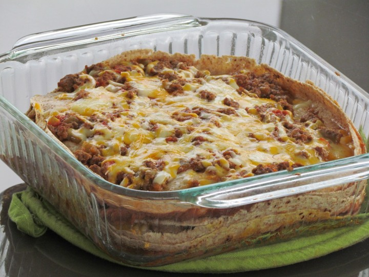 Layers of tortillas, meat, cheese, and refried beans makes this mexican-style lasagna a family favorite