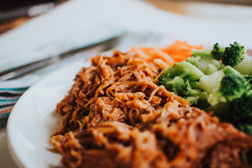 Pulled pork on a plate with broccoli
