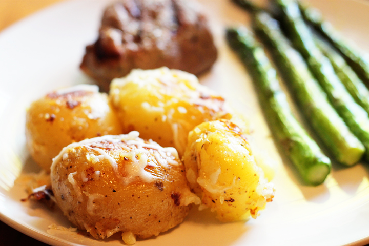 Delicate yukon gold potatoes are steamed and then covered in butter and parmesan cheese. Quite likely to become your next favorite side dish.