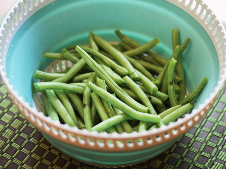 Fresh green beans in a strainer