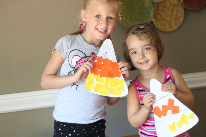 kids holding candy corn halloween craft