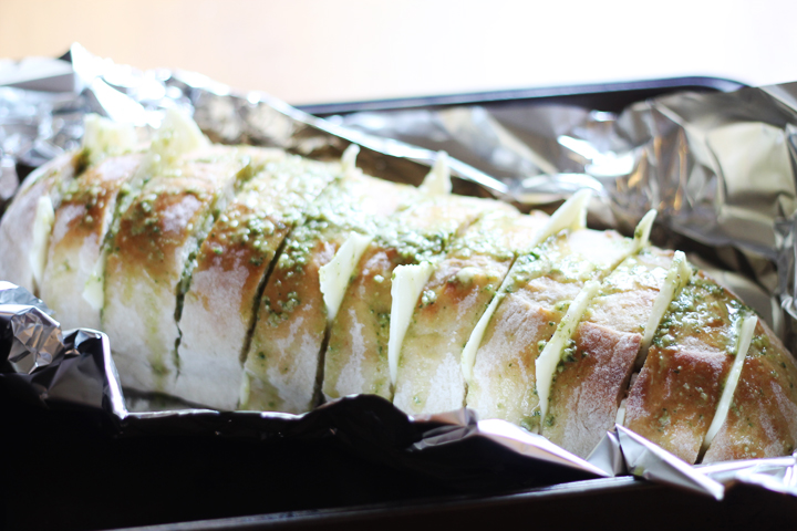 Pesto cheese bread. A delicious twist on the average garlic bread that you may throw in the oven. My husband can't get enough of this stuff!
