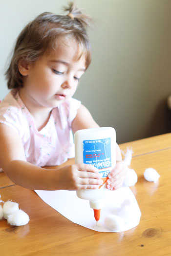 little girl making puffy ghosts