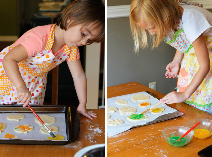 painting pumpkin cookies with icing