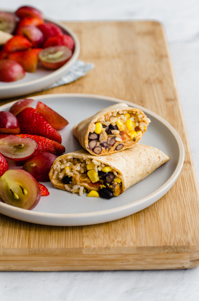 freezer-friendly lunch wraps on a wooden cutting board