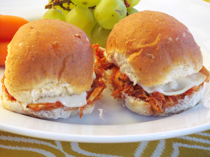 Chicken Parmesan Sliders is the easiest crockpot meal you might ever make. The family will go nuts for this one!