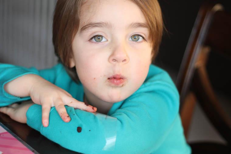 Girl eating chocolate zucchini bread