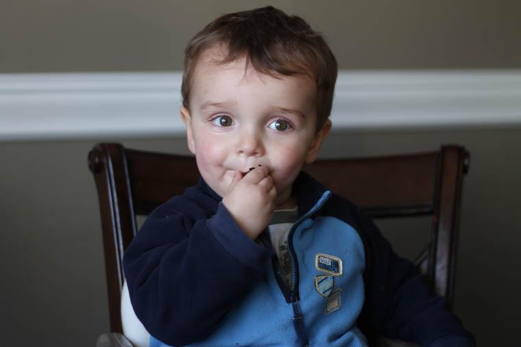 Boy eating chocolate zucchini bread