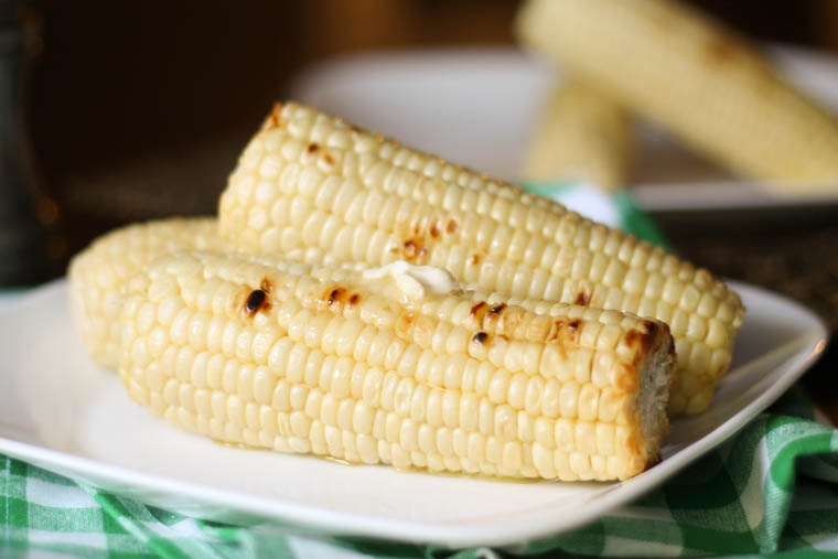 A great little trick that will help you grill flawless corn on the cob. In fact, we will grill corn no other way after using this method. While you could easily boil corn on the cob, grilling corn brings out a different, richer flavor and adds that yummy char to the outside of the corn.