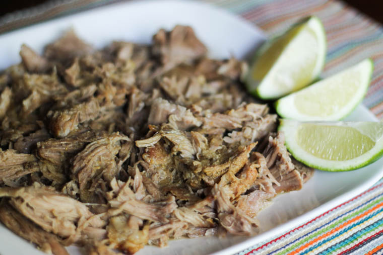 Pulled pork on a plate with limes