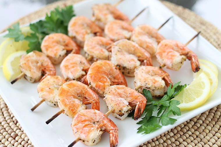 Freezer Friendly Mediterranean Shrimp. Even the most reluctant seafood eaters will enjoy this succulent lemony shrimp. Broiling for only a few minutes on each side creates a crisp exterior while maintaining a juicy interior. The skewers and beautiful garnishes make this easy dish a fun one to serve for family dinner or as a party appetizer.