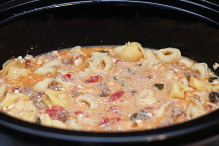 Finally, a slow cooker recipe that is SUPER easy to make yet packed with flavor. The creamy goodness of this crock pot sausage tortellini soup is a win with all ages and makes for great lunch leftovers.