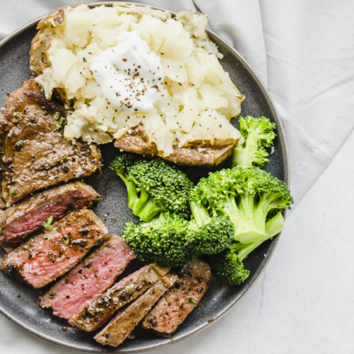 seasoned cooked steak that is sliced on a plate