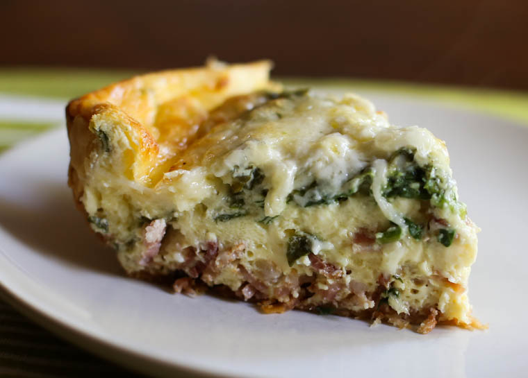 slice of baked quiche on a plate