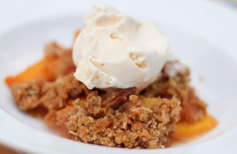 Pecan peach crisp dessert. Heaven help me, this fruit bake was delicious. Super easy to make too!