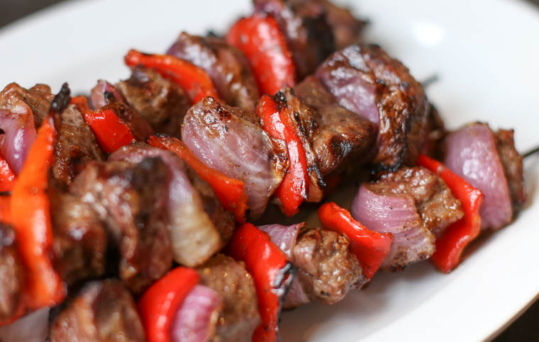 Close up of grilled sirloin steak kebabs