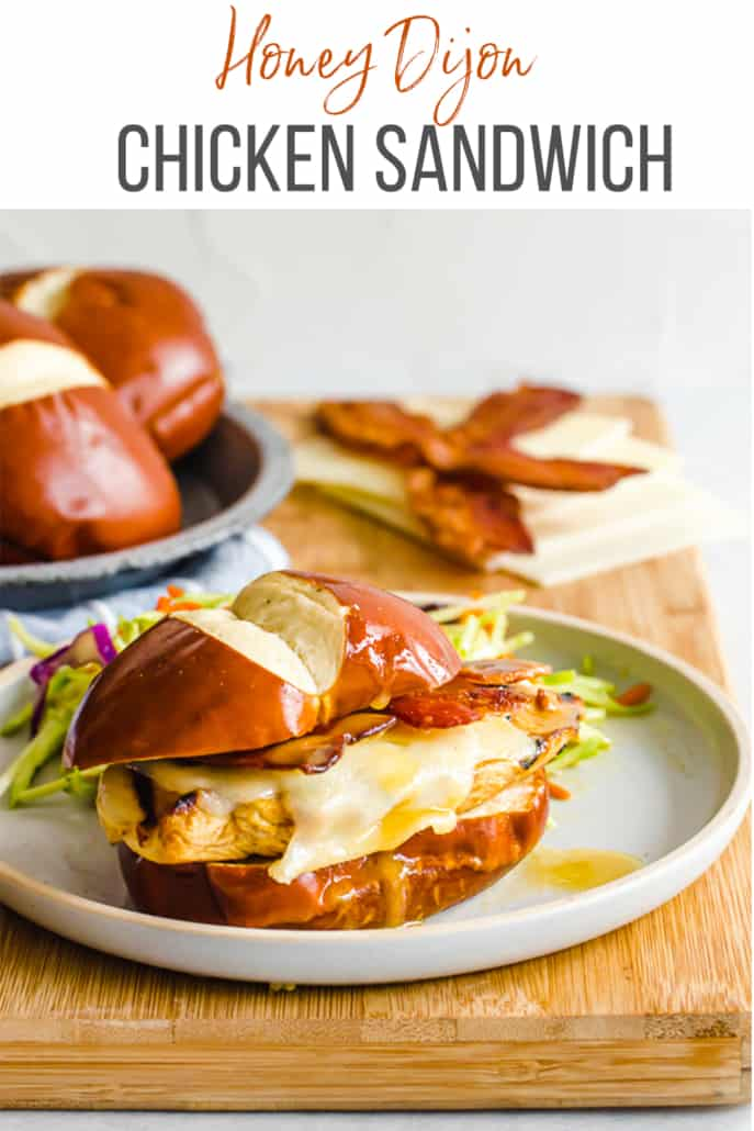 chicken sandwich on a pretzel bun on a plate