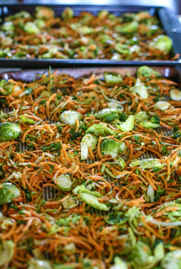 Raw shredded vegetables on a baking sheet