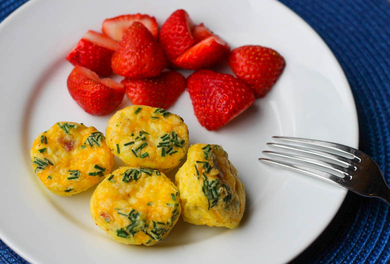 egg muffins and strawberries on a plate