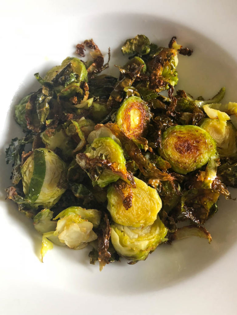Roasted Brussels Sprouts in a while bowl