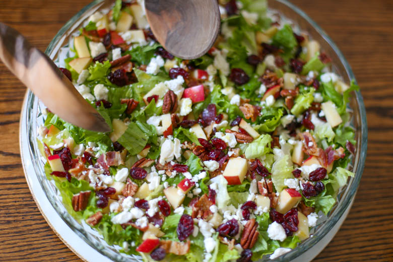 Autumn Chopped Salad in a bowl with tongs