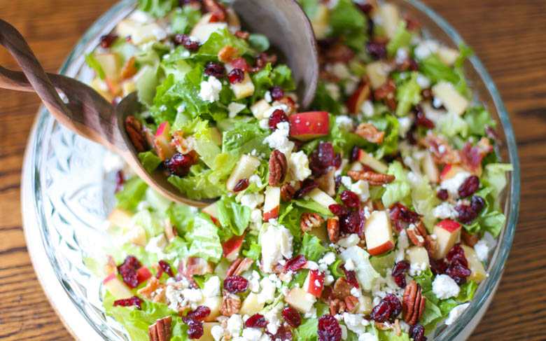 Mixing autumn chopped salad