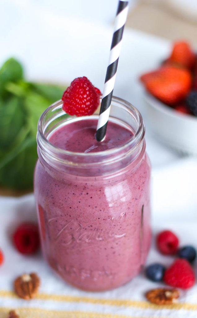 berry smoothie in mason jar with straw