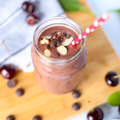cherry smoothie in mason jar with straw