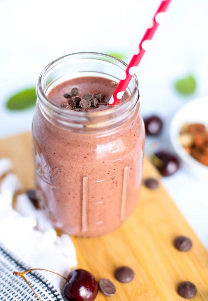 cherry smoothie in mason jar with straw