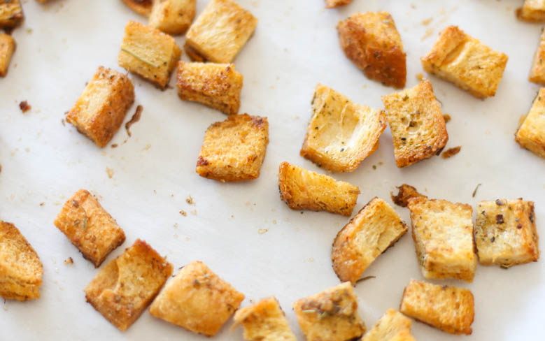 Homemade croutons on parchment paper