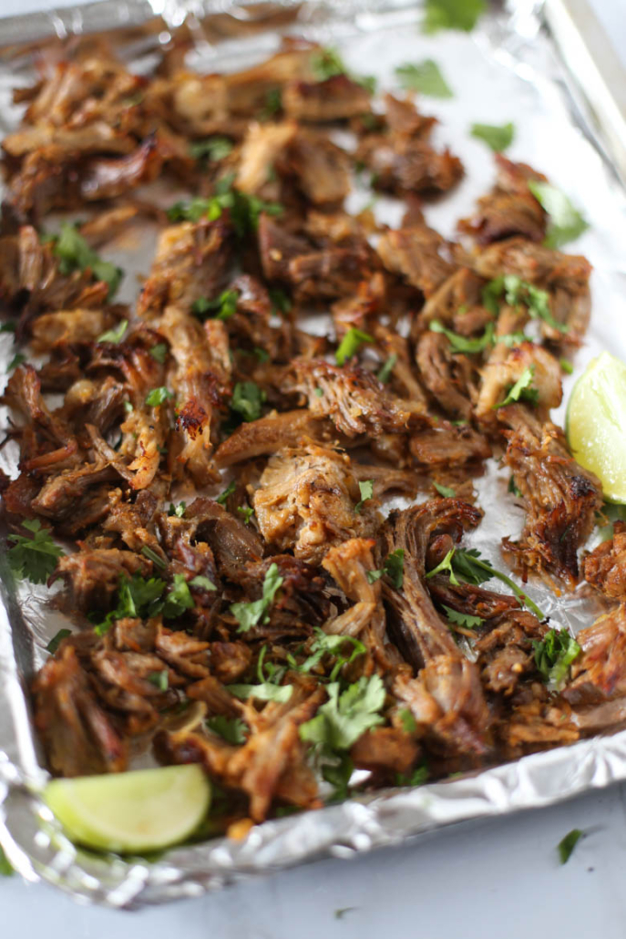 gluten-free carnitas shredded on a sheet pan