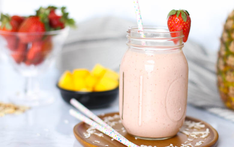 strawberry smoothie in mason jar with straw