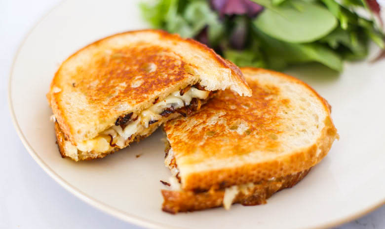 Gourmet Grilled Cheese on a plate with salad
