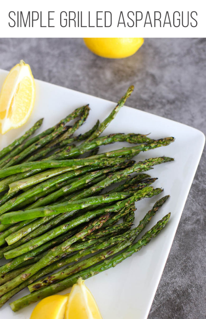 Grilled asparagus on a white plate