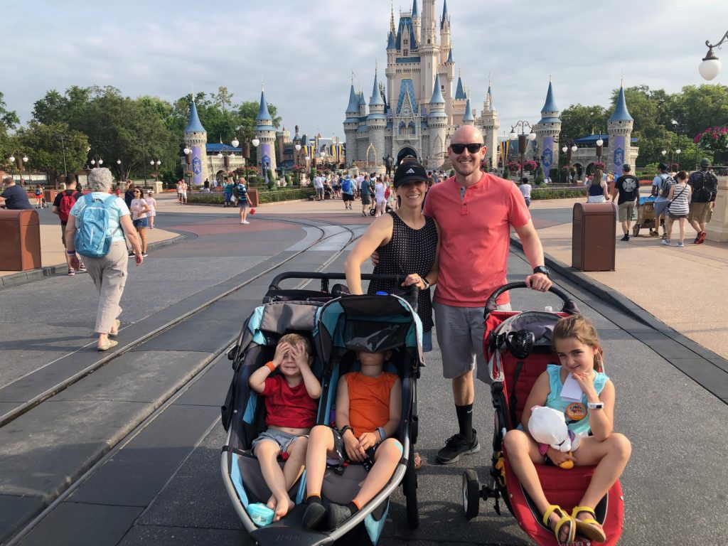 Conner family in front of Magic Kingdom