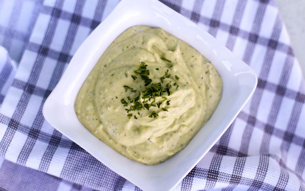 homemade avocado garlic aioli in a white bowl
