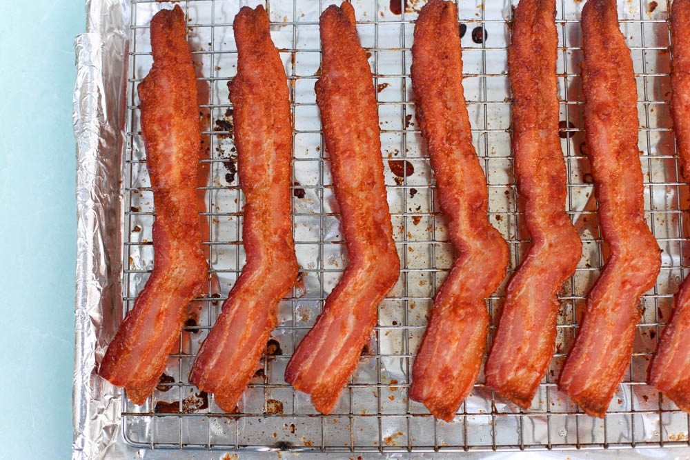 Cooked bacon on a cooling rack