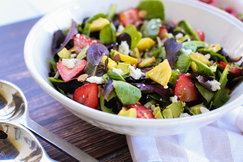 Strawberry avocado salad in a white bowl